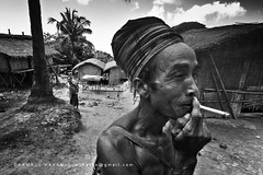 Faces of the hills (Kamrul - Hasan) Tags: people house man living woamn smoke lifestyle cigar smoking bangladesh indigenous mro morong cigarate premitive