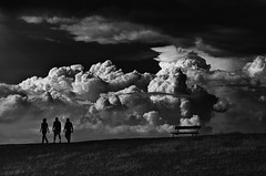 """Friends"" (helmet13) Tags: d90 raw bw sky clouds people silhouette siderail bench dike meadow lowkey gloomy world100f studies 200faves"