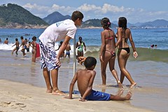 Boys having fun at the beach (alobos Life) Tags: boy red sea brazil sky sun playing man cute men guy sol praia beach boys water colors beautiful rio azul brasil canon de fun outdoors eos rebel mar sand agua janeiro body candid garoto playa guys colores arena copacabana cielo enjoy brazilian alegria speedo having garotos sunga chicos jugando divertido t1i