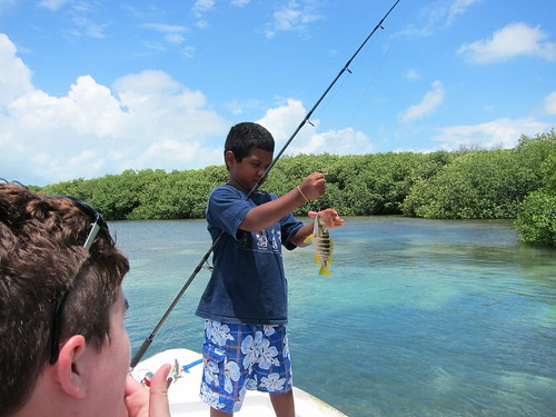 Justin catching a fish