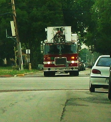 A Norwood Park Fire Department tower truck returning to base.  Harwood Heights Illinois USA. July 2011. by Eddie from Chicago