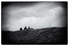Four contemplating weather (◄bl►) Tags: sky people blackandwhite bw nature ecology geotagged person iso100 blackwhite scenery europe skies belgium belgië human environment environmentalism humanbeing humans ecosystem flanders humanbeings doel personalfave vlaanderen beveren canoneos5d variouspeople ef70200mmf4lusm flemishregion 1800secatf56 cvkc