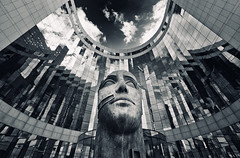 Head (Philipp Klinger Photography) Tags: light shadow sky bw sculpture white house distortion black paris france reflection building eye tower art glass architecture clouds skyscraper reflections mouth nose la blackwhite eyes nikon frankreich europa europe distorted head ladefense and curve curved philipp iledefrance defense ladfense entrace dfense puteaux klinger d700 dcdead