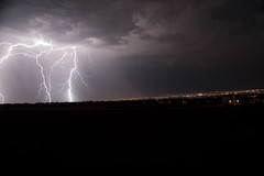 Lightning over Albuquerque (Stevenh1979) Tags: city longexposure sky storm newmexico rain bulb night canon dark lights albuquerque citylights slowshutter strike lightning nm thunder eos500 t1i