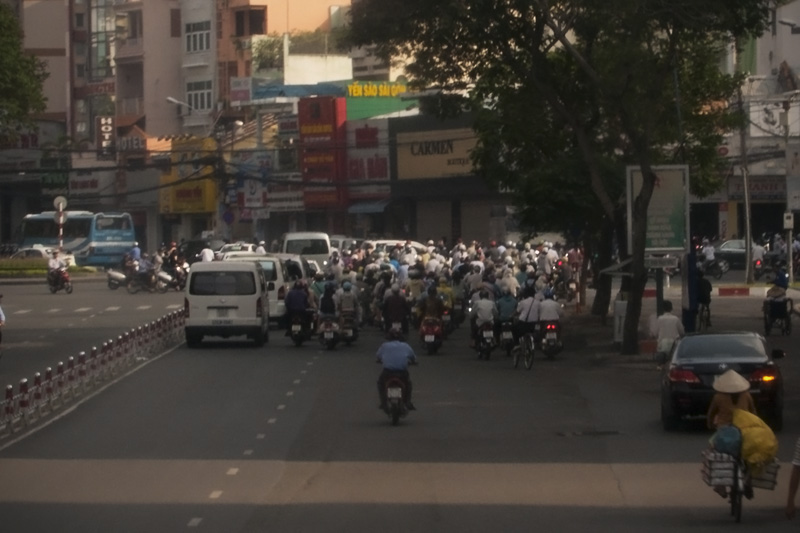 Motobikes take up most of the road in downtown Siagon.  Helmet laws make for some pretty fantastic protective fashion.  Quite a difference from the silent sweeping noises of Chinese electric scooter as these guys hum all around the city.