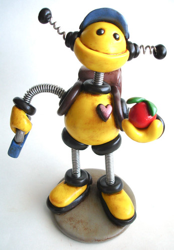 Yellow Yeva School Boy Robot Sculpture by HerArtSheLoves