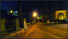 St. Cuthbert's Kirkyard at Night (Hetx) Tags: road uk flowers light orange black building green church window silhouette parish stone wall night dark concrete outside death scotland twilight memorial edinburgh europe stair european moody shadows exterior darkness unitedkingdom buried path reverend stonework capital tomb masonry decoration scottish landmark medieval graves nighttime scot midnight burial churchyard priest cuthbert baroque newtown tombstones rev sculptural middleages gravestones incandescent pathway kirk presbyterian lothian mediaeval monumental stcuthberts shadowy lothianroad kirkyard sepulchre presbyterianchurch ashlar auldreekie baroquechurch daviddickson parishchurchofstcuthbert