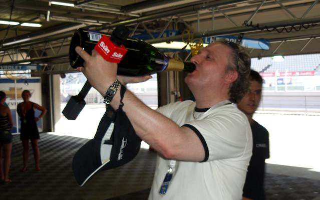 Jim Munro drinks Rob Huff's Champagne