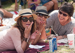 Three Laughing Ladies (TXphotoblog) Tags: park street portrait people urban woman cute beautiful smile hat sunglasses fashion festival female sanantonio downtown pretty texas candid perspective adorable photojournalism naturallight event laugh lovely graceful flickrpost travispark jazzsalive2011