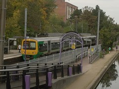 Bournville Station and the Worcester and Birmingham Canal - ramp for the canal - London Midland train 323215 (ell brown) Tags: greatbritain bridge autumn england train birmingham ramp unitedkingdom cadbury bournville cadburys westmidlands indiansummer stirchley class323 bournvillestation londonmidland worcesterandbirminghamcanal crosscityline bournvillevillagetrust londonmidlandcity leahousebridge maryvalerd