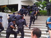 Group of cops chases away people in menara maybank by freemalaysiatoday
