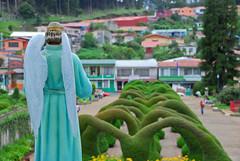 Overlooking Zarcero (Brian Sloane) Tags: park parque green church bush costarica arch amy zarcero
