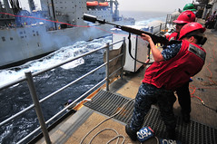 Sailor fires a shot line from USS Boxer to USNS Alan Shepard during a replenishment at sea (Official U.S. Navy Imagery) Tags: people navy sailor usnavy amphibiousassaultship gulfofaden militarysealiftcommand ussboxerlhd4 ctf151 combinedtaskforce151 usnsalanshepardtake3 drycargoandammunitionship