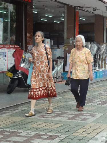 Two beautifully attired older women
