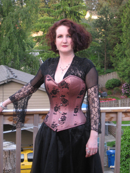 Pink corset with black lace overlay