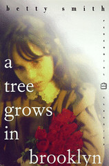 Cover of A Tree Grows in Brooklyn by Betty Smith. The cover shows a young white girl wearing a brown dress and holding a bouquet of red roses.