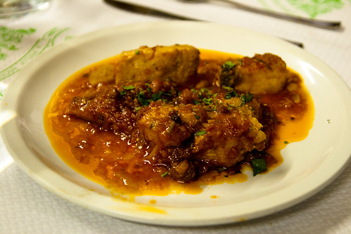 Baccala alla livornese (Baked Codfish with Prunes, Onions, and Tomato Sauce) at Enoteca Corsi
