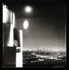 Two Moons Over Downtown LA (tobysx70) Tags: california park ca city toby 2 two bw white black slr sepia night silver project polaroid sx70 lights la los pod downtown cityscape angeles uv poor illuminated observatory tip shade 600 hollywood frame moons lit hancock griffith floodlit 680 impossible the px silvershade theimpossibleproject px600uv tobyhancock impossaroid