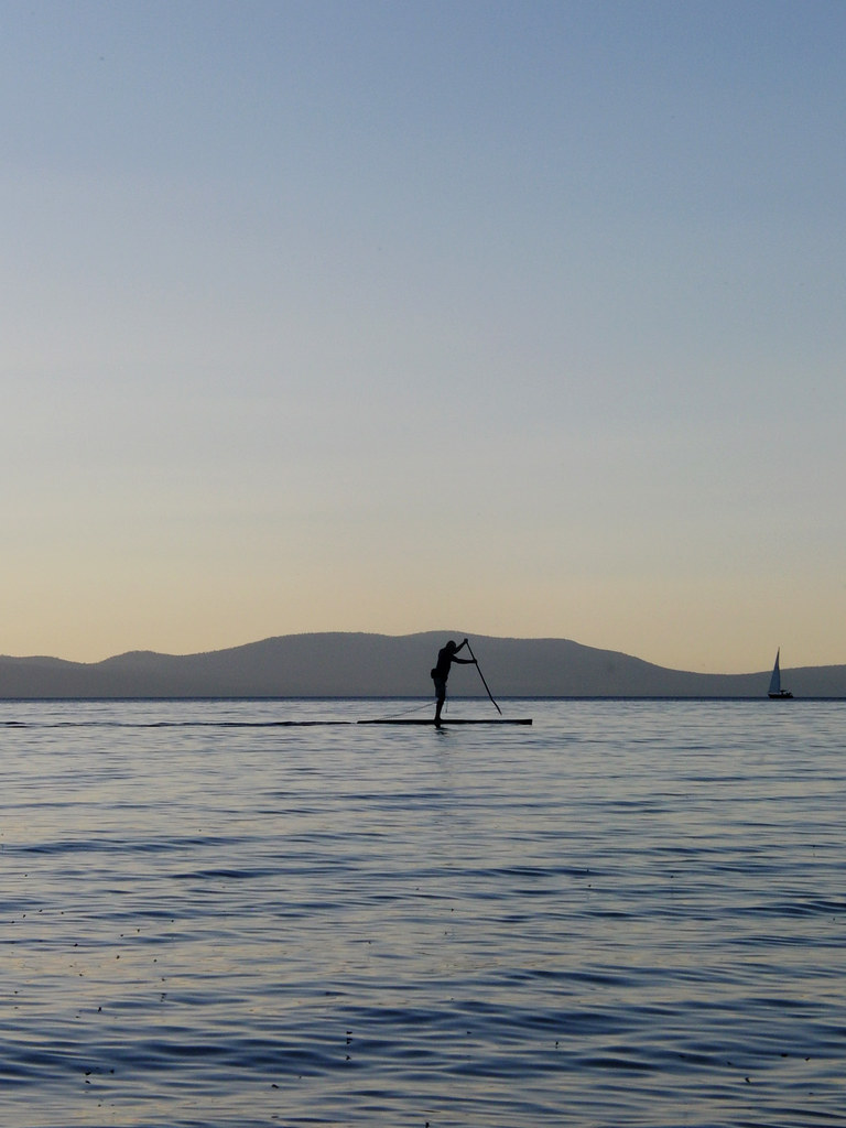 paddle boarder at 1/400 seconds, f/5.7, 19mm, ISO 100