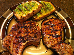 Grilled garlic scape toast and local grass fed porkchops
