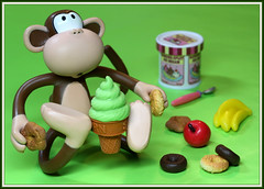 Decisions, decisions (Rigib) Tags: feet apple canon monkey mono cone bananas donuts icecream macaco 60mm abe decisions affe  mapa  f110 img5204 lens00025 bobbyjack  365toyproject  ourdailychallenge