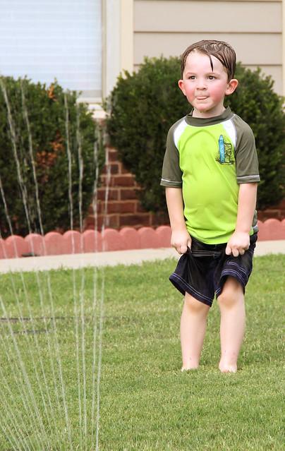 Garrett in the sprinklers