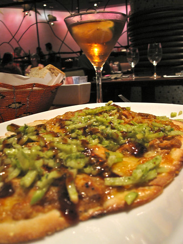 Barbecue Chicken Flatbread - Served with grilled onion, apple-jicama slaw, African barbecue sauce, and four cheeses