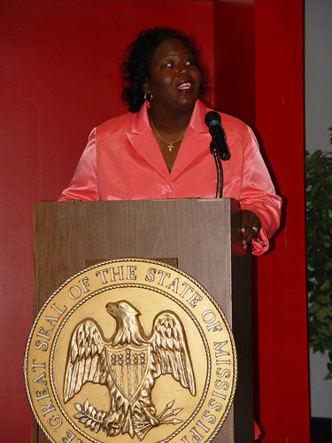Mississippi's State Director of USDA Rural Development Trina George addresses a crown of hundreds to mark an award of $13 million to expand an industrial park in Lowndes County in Mississippi.
