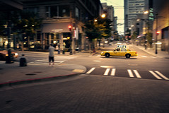 panning cab (sparth) Tags: road seattle leica people car yellow night speed blurry downtown cab taxi july panning x1 2011 leicax1
