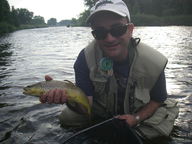 Paul with his first dry fly brown trout