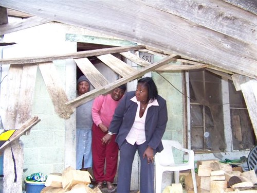 Mississippi's USDA Rural Development State Director Trina George tours the old home of Ms. Monger in January 2011.