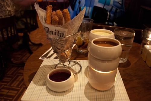 Crystal Sugar Churros Fondue with muddled raspberries and two chocolate dipping sauces