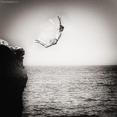 il volo dell'angelo (vola solo chi osa farlo) (LucaSpagnolo) Tags: mare volo cielo salto tuffo scogliera canoneos450d totalphotoshop gennaio2012challengewinnercontest
