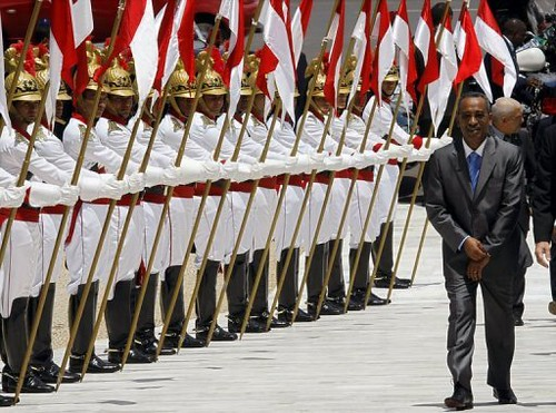 Prime Minister of Sao Tome Joachim Rafael Branco facing the honor guard in his country. The country will undergo national elections very soon. by Pan-African News Wire File Photos