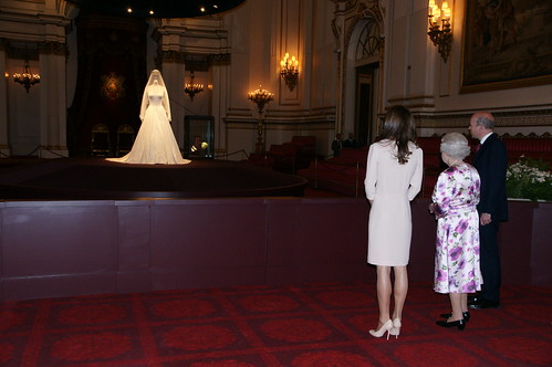 The Queen and The Duchess of Cambridge visit the wedding dress exhibition at Buckingham Palace
