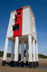 Burnham-On-Sea Lighthouse (Mukumbura) Tags: wood uk blue light red england sky lighthouse white beach stairs outdoors coast wooden sand lighthouses mud legs unitedkingdom dunes somerset safety mudflats navigation piles burnhamonsea quicksand lighthouseonlegs summertimeuk