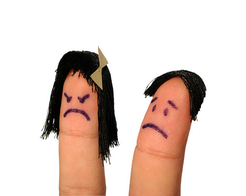 A finger-puppet couple with the wife visibly angry at the husband
