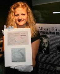 Einstein Landing Card, held by curator Lucy Gardner
