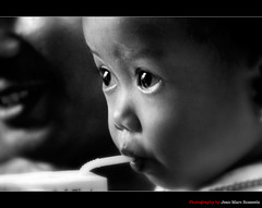 The Eyes (jean-marc rosseels) Tags: blackandwhite bw baby canon indonesia kid eyes straw surabaya canon7d