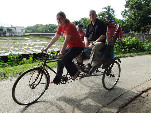 Iona carrying  Justin by a rikshaw