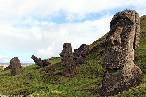 Partially buried moai remain