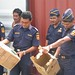 Indonesian customs officers inspect a seizure of smuggled CFC cylinders produced in China, Tanjung Priok port, Jakarta, Indonesia, 2004.