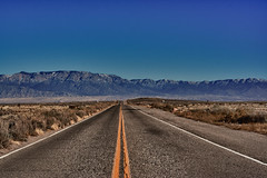 Sandia Mountains (John Vanderbeck) Tags: road blue winter usa brown mountain newmexico southwest landscape highway unitedstates desert northamerica grassland sandia thechallengefactory