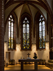 Dim interior of the Protestant church shot handheld with an Olympus E5 DSLR.