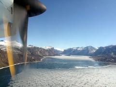 The Turn at Pangnirtung (subarcticmike) Tags: travel canada tourism geotagged flying aviation tourist aerial arctic nunavut fiord permafrost breakup dash8 windowshot baffinisland pangnirtung glaciation glaciated canadiannorth subarcticmike pleasecleanthewindows kittensfeet