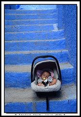The Sleeping Baby and the Blue Stairs - Bb dormant et escaliers bleus (Rachid Naim) Tags: voyage africa trip blue sleeping baby girl stairs children child sleepy morocco maroc maghreb casablanca safi chefchaouen et enfant fille bb maxi tanger asi dormant  afrique  sucette escaliers the dort bleus   landeau