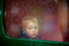 (penwren) Tags: portrait green window glass look rain station train canon sussex child carriage raindrops 18 glance steamtrain ©allrightsreserved explorefp canoneos5dmarkll