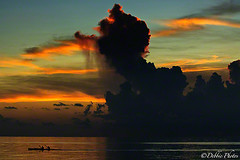 Cloudy Silhouette Sunset (D. Photos) Tags: sunset orange beach water bluesky cayman caymanislands grandcayman sevenmilebeach nikoncamera nikond200 ominousclouds silhouettesunset caribbeansky debbiephotos caribbeanclouds ringexcellence dblringexcellence tplringexcellence caymanislandsclouds debbiephotossunset