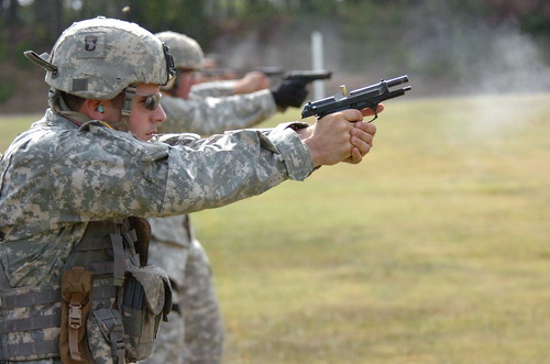 Staff Sgt. Jefferey Ice is firing the pistol.