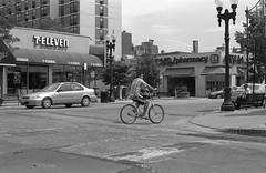Broadway and Barry (Fogel's Focus) Tags: chicago 50mm f14 olympus 150 bicycles rodinal zuiko 20c fomapan100 agfarodinal om1n 7min fomafomapan film:iso=100 film:brand=foma developer:brand=agfa developer:name=agfarodinal film:name=fomafomapan100 filmdev:recipe=6346